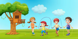 Children skipping rope in the park Stock Photo