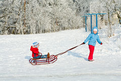 Children with sled Stock Photography
