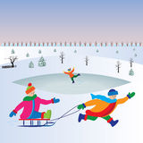 Children with sled. Christmas Holidays. Stock Photography