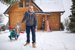 Children sledding with his father Stock Photo