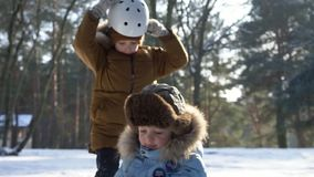 children sledding on snow active fun for family christmas vacation stock footage video of forest frost 119358424 - Christmas Vacation Sled