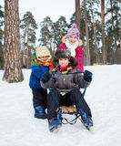 Children on sleds in snow Royalty Free Stock Images