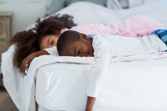 Children sleeping on bed Royalty Free Stock Photo
