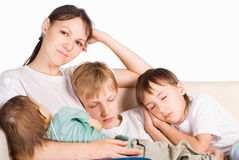 Children sleeping with mom. Portrait of a sleeping family on a white Stock Image