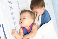 Children sleeping together. Little baby, boy and kitten sleeping together Stock Images