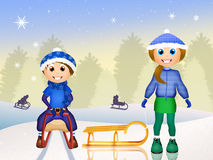 Children on sleigh in winter Royalty Free Stock Images