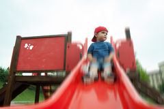 Children on slide Royalty Free Stock Photos