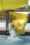 Children slide down a water slide Stock Images