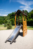 Children slide in green garden with blue sky Stock Photo