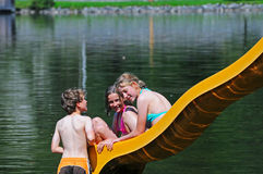 Children on slide at lake Royalty Free Stock Images