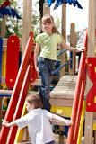 Children on slide outdoor in park. Royalty Free Stock Photography