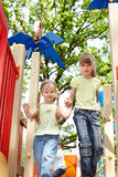 Children on slide outdoor in park. Royalty Free Stock Images