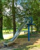 Children slide at pubic park. In summer season royalty free stock photo