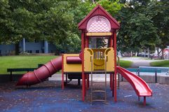 Children slides. Playground in the summer park after rain royalty free stock images