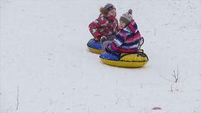 Children slides from the mountain in the snow stock video footage