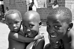 Children Of The Slums In Kampala Africa. KAMPALA, UGANDA, AFRICA - CIRCA JANUARY 2009:  Unidentified children smile and laugh circa January 2009 in the slums of Stock Photo