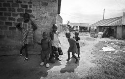 Children in the slums of Kampala. Children photographed playing in the slums of Kampala. Despite the conditions they appear happy and smiling Royalty Free Stock Photo