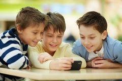 Children with smartphone Stock Images