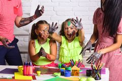 Children smiling with hands colored in paints. Girls painters painting with parents. Kids learning and playing. Arts and crafts. Happy childhood and family royalty free stock images