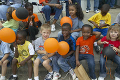Children smiling and holding balloons at parade in Central GA Stock Photography