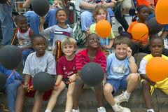 Children smiling and holding balloons at parade in Central GA Stock Image
