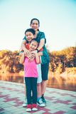 Children smiling and hugging each other. Loving and bonding of s stock photography
