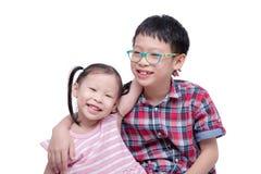 Children smiling over white background Stock Photos