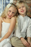 Children - smiling sibling. Sister and brother Stock Images