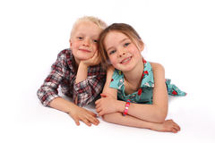 Children Smiling Whilst Lying Down. Stock Photos