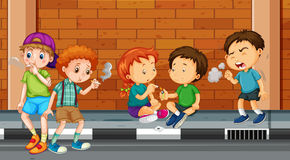 Children smoking and doing drugs on the street Stock Photo