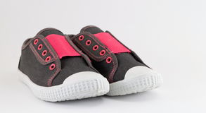 Children sneakers on white Stock Images