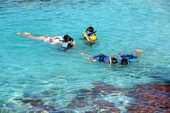 Children snorkeling. Children enjoying snorkeling  in Pulua Redang, Malaysia Royalty Free Stock Images