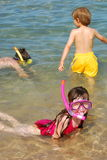 children snorkeling at beach royalty free stock images