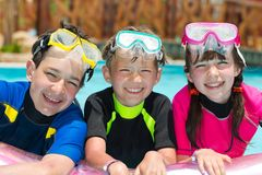 Children snorkeling in pool Stock Photo
