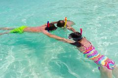 Children snorkeling in sea Stock Photo