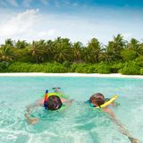 Children snorkeling in tropics Royalty Free Stock Photo