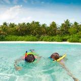 Children snorkeling in tropics royalty free stock photo