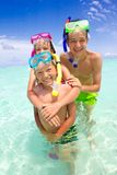 Children with snorkels in sea Stock Images