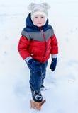 Children on snow Royalty Free Stock Image