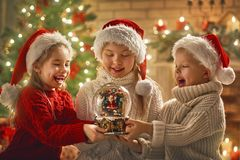 Children with snow globe Royalty Free Stock Photo