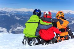 Children in snow on mountain Stock Photo