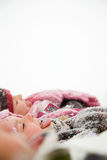 Children in snow sticking their tongues out Royalty Free Stock Image