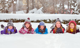 Children on snow in winter time Stock Image
