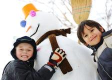 Children with snowman Stock Photo