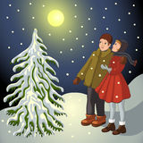 Children in snowy landscape. 2 children in snowy landscape with moon and christmas tree Royalty Free Stock Images