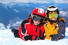 Children on snowy mountain Royalty Free Stock Photo