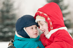Children at snowy winter outdoors Royalty Free Stock Image