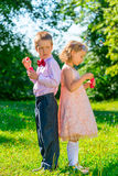 Children and soap bubbles. Funny kids on a holiday makes soap bubbles stock photos