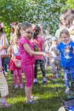 Children and soap bubbles. Happy children playing with soap bubbles on May 30, 2015 in Bucharest, Romania royalty free stock image
