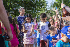 Children and soap bubbles. Happy children playing with soap bubbles on May 30, 2015 in Bucharest, Romania royalty free stock images